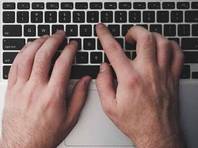 img man typing with keyboard - 7 Tips to Get Quality Comments and Feedbacks - 1